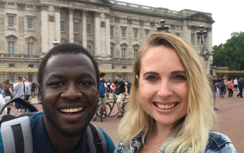 Guy and Girl outside Buckingham Palace